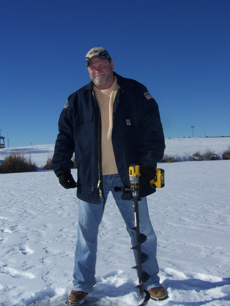 Jeff Hayward is seen checking the ice thickness on Swan Lake in preparation for the annual Heartland Acres Ice Fishing Derby to be held Sunday, Feb. 11. Attendees as well as the public are invited out for the Lions Club Brunch which will run from 8AM to noon.